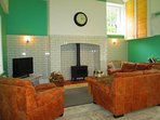 Leather corner Sofa and chair for Dad, Log burner also for Dad