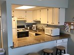 Kitchen w/Granite Counter and Breakfast Bar & 3 Stools