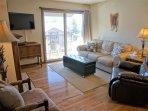 Hardwood floors, leather furniture, HDTV