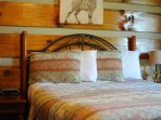 Main level bedroom, 1 queen, private ensuite shower bath with washer/dryer. LINENS ARE PROVIDED!