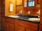 Double sinks in the large, ensuite bathroom in the main level master bedroom
