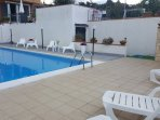 Private swimming pool, equipped with deckchairs and umbrellas