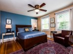 Fireside Suite with walk-in closet, glass-tiled hearth, luxury queen bed & quality bedding.