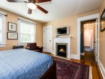 Fireside Suite with flat-panel TV/cable, WiFi, glass-tiled hearth, walk-in closet and ensuite bath.