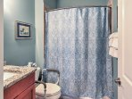 This second bathroom is handicap accessible and boasts a shower/tub combo.