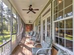 Bring a cocktail outside to the screened porch as your kids run around the yard.