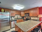 Prepare delectable meals in the fully equipped kitchen, enhanced with granite countertops, stainless steel appliances...