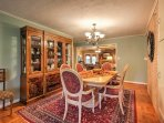 For a memorable dining experience with your loved ones, gather at the dining room table set for 4.