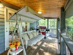 With 2 screened-in porches and a large deck, this home offers many spots to kick back, relax and enjoy the tranquil...