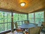 Enjoy a meal on the screened-in porch.