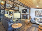 The beautifully furnished interior offers a blend of rustic and chic styles.