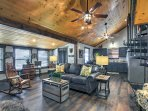 The living space features vaulted ceilings and an open-floor layout.