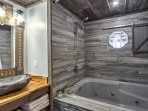 Sleek grey accents and a shower/tub combo finish off this bathroom.