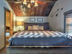 Collapse into this king bed in the master after exploring the Smoky Mountains!