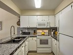 In the fully equipped kitchen, you'll find updated appliances and ample counter space.