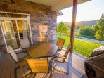Gorgeous deck view with grill and 6 deck chairs