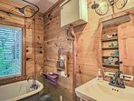 This bathroom comes complete with a Clawfoot tub and overhead shower head.