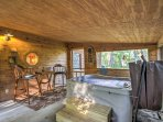 Head inside this shed, where you'll find a small bar area and hot tub.