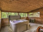 Relieve all your stress with a soak in the hot tub.