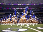 Dallas Cowboys Cheerleaders performing on the AT&T Stadium Field.