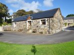 The Byre is a new build stone cottage and forms the West end of a Barn complex on an old farm yard.