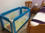 Cot which has a top attachment to place a baby in.