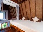 3rd bedroom on a mezzanine level above master bedroom, shared bathroom, 2 singles