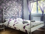 Our romantic decorated bedroom with a double bed