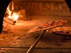 BBQ plus wood fired pizza oven overlooks the pool and Olive grove fully illuminated at night.