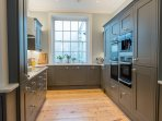 Spacious main kitchen with Neff ovens and steam oven and Gorenje bean to cup coffee machine