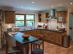 Large kitchen /dining room with breakfast bar and adjacent utility room