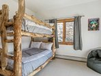 Bedroom 3, located on the main living area, with twin over twin bunk beds and access to a small deck.