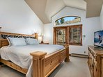 Master bedroom with king bed, private deck, flat screen TV and en suite bathroom.