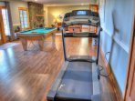 Treadmill and Pool Table on lower level