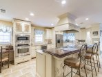 European-Inspired Kitchen: Granite, Stainless and Beverage Center