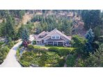 Home in the trees in the Mission area of Kelowna, Very private. Stunning views.