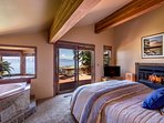 Master bedroom, with private deck access, a fireplace, and king bed