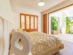 Master bedroom with a picturesque view
