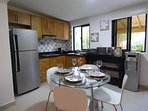 Spacious dining space and Kitchen, prepared with all the utensils and appliances needed.