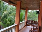 The upper balcony a perfect place for you to get quiet moments and relax overlooking the sea.