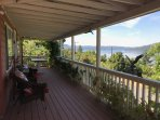 Front porch with a beautiful view of the lake and river.  Eat your meals or just relax.