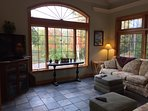 Family Room with nice views and easy access to the outdoor hot tub.
