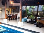Lakshmi Villas Ubud - Living and dining area by the pool
