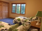 Large second floor Twin bedroom with river views.