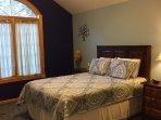 Second floor bedroom with Queen bed and vaulted ceilings.