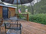 Enjoy spending time on the private deck with beautiful wooded views.