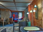 The enclosed porch offers a funky cosmo-themed daybed.