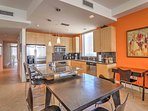 The fully equipped kitchen features granite counter tops and stainless steel appliances.