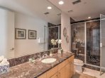 Three full bathrooms are stocked with complimentary toiletries and fresh towels.