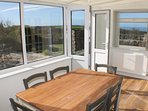 Enjoy sea views from the dining room all year round